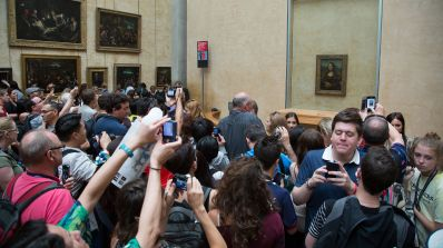 'Crowd looking at the Mona Lisa at the Louvre', photograph by Victor Grigas.